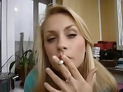 Hot babe smoking cigarette acting sexy
