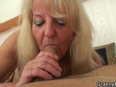 70 years old granny in stockings riding