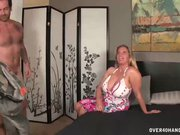 Busty milf jerks off a young dude