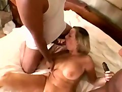 Big tit granny takes two massive black cocks