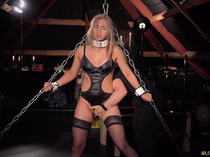 Bondage porn for busty slave performing oral